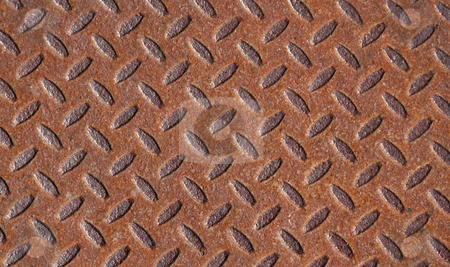 Rusted Metal Pattern stock photo, A rusted metal with a grate pattern. by Chris Hill