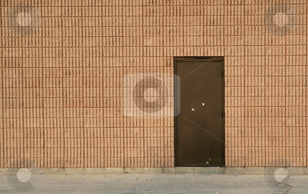 Door and Brick Wall stock photo, A brick wall and a brown door. by Chris Hill
