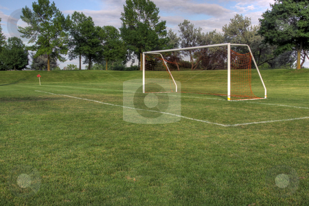 Vacant Soccer Goal stock photo, An empty soccer goal with trees in the background. (HDR photo)  by Chris Hill