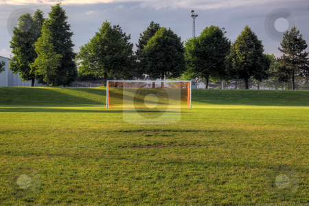 Empty Pitch stock photo, An empty soccer goal with trees in the background. (HDR photo)  by Chris Hill
