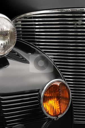 Antique car grill stock photo, The chrome grill and headlights of an antique classic car. by © Ron Sumners