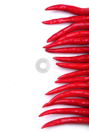 Chili as border on right stock photo, Column of red chilies as border on right  by smarnad