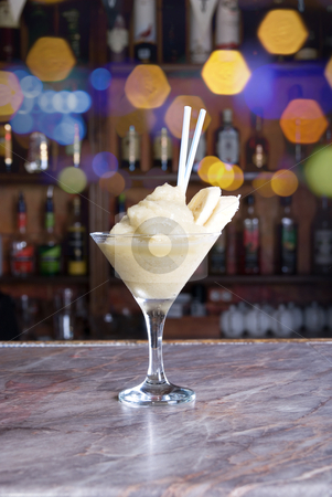 Banana frozen cocktail stock photo, banana frozen cocktail on the wooden bar by olinchuk