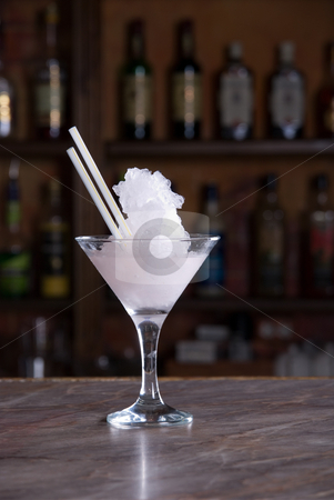 Frozen cocktail stock photo, pink frozen cocktail on the wooden bar by olinchuk