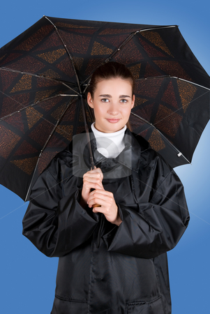 Umbrella stock photo, pretty brunette girl at black coat under umbrella by olinchuk