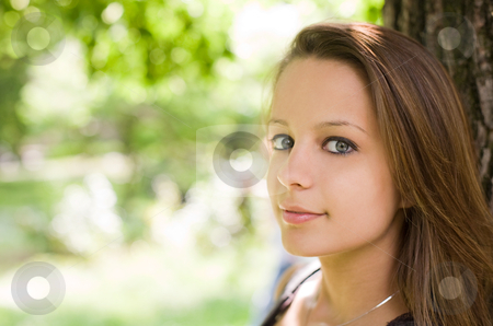 Cutiepie stock photo, Closeup portrait of a beautiful cute young smiling brunette teen girl with copy space. by exvivo
