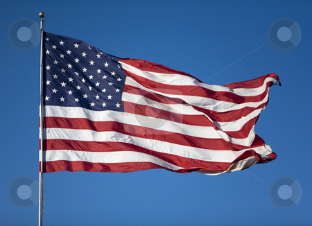 United States Flag blowing in the wind stock photo, Very large United States Flag blowing in the wind on a cloudless day by digitalmedia