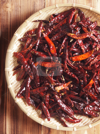 Basket of dried red chilies stock photo, close up of a basket of dried red chilies by zkruger