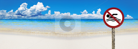 Tropical beach with sign saying no swimming stock photo, Tropical beach with sign warning to not swim by tish1