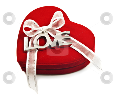 A Red heart with the word love spelled out in silver stock photo, a Red heart with the word love spelled out in silver on a white ribbon by tish1