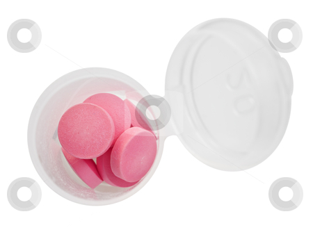 Pink pills and pill bottle on white background stock photo, Pink pills and pill bottle on white background with space for text by tish1