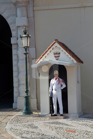Single Monaco Guard stock photo, LA CONDAMINE DISTRIC, MONACO - OCTOBER 1st, 2009 - The palace guard standing at attention at the main entrance, taken on October 1st, 2009 in La Condamine Distric of Monaco by Kevin Tietz