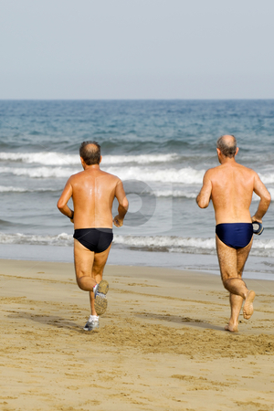 Running men stock photo, Old men is running on the beach by Lars Christensen