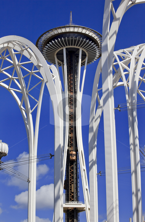 Space Needle Arches Pacific Science Center Blue Skies Seattle Wa stock photo, Space Needle Steel Arches Clouds Pacific Science Center Seattle Washington Central structure for the 1962 Worlds Fair by William Perry