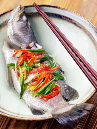 Asian steamed fish stock photo, close up of asian steamed fish by zkruger