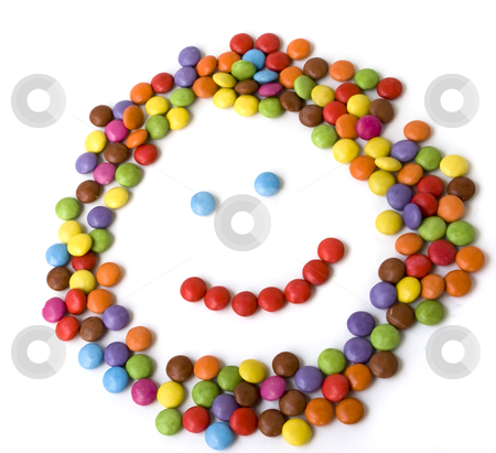 Colorful candies stock photo, colorful candies made in kid face shape isolated on white background by Desislava Dimitrova