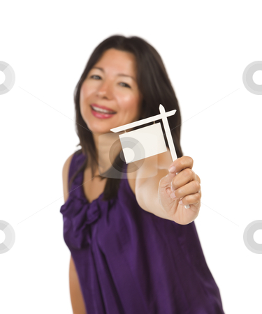 Multiethnic Woman Holding Small Blank Real Estate Sign in Hand stock photo, Attractive Multiethnic Woman Holding Blank Small Real Estate Sign in Hand Isolated on White Background Ready for Your Own Message. by Andy Dean