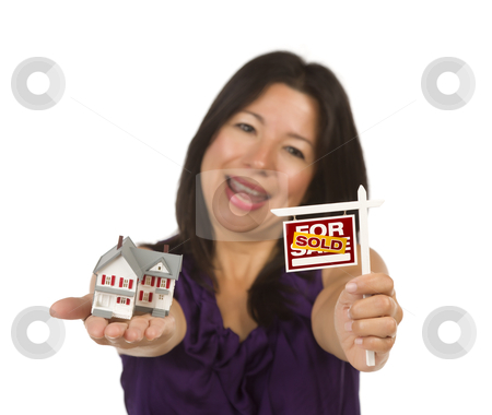 Multiethnic Woman Holding Small Sold For Sale Real Estate Sign a stock photo, Multiethnic Woman Holding Small Sold For Sale Real Estate Sign and House in Hand Isolated on White Background. by Andy Dean