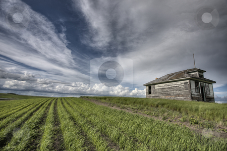 Abandoned Farm stock photo, Abandoned Farm with storm clouds in the Canadian Prairie by Mark Duffy