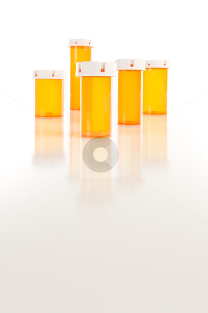 Empty Medicine Bottles on Reflective Surface stock photo, Several Different Sized Empty Medicine Bottles on Reflective Surface. by Andy Dean