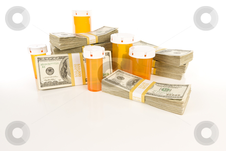 Medicine Bottles and Stacks of Hundreds of Dollars stock photo, Empty Medicine Bottles and Stacks of Hundreds of Dollars on Reflective Surface. by Andy Dean