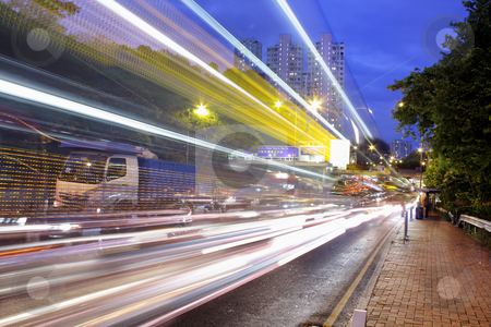 Fast moving cars at night  stock photo, Fast moving cars at night  by Keng po Leung