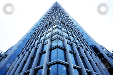 Modern building with reflections  stock photo, Modern office building with reflections  by Keng po Leung