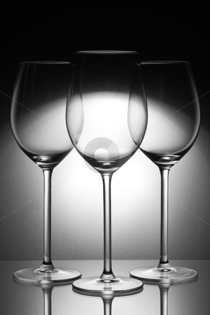 Three glasses stock photo, Three glasses on glass plate by redpike42