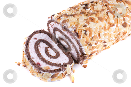 Nuts Swiss roll stock photo, Nuts Swiss roll closeup isolated on a white background by olinchuk