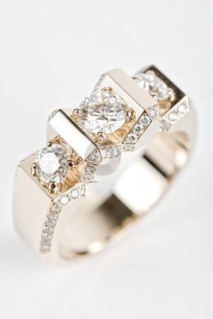 Ring stock photo, Ring of gold and white gold on white by olinchuk