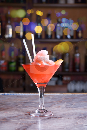 Frozen cocktail stock photo, red frozen cocktail on the wooden bar by olinchuk