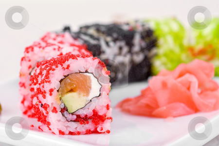 Sushi rolls stock photo, Sushi rolls made of salmon, avocado, flying fish roe (tobiko caviar) and philadelphia cheese by olinchuk