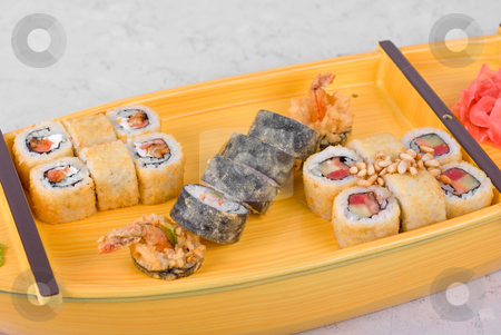 Sushi ship stock photo, japanese food of wooden ship with various type of sushi by olinchuk