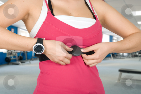 Checking pulse watch stock photo, Girl with checking pulse watch closeup by olinchuk