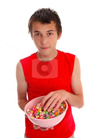 Boy with a bowl of candied popcorn stock photo, A boy with colourful tasty popcorn in a large bowl.  White background. by Leah-Anne Thompson