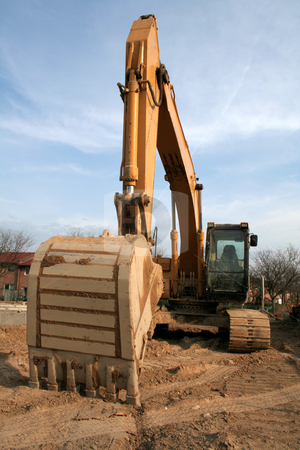 Wide Angle Backhoe stock photo, A wide angle shot of a backhoe at a new housing development.  by Chris Hill