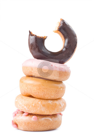 Stack of colorful and delicious donut stock photo, Stack of colorful and delicious donut isolated on white background by Lawren