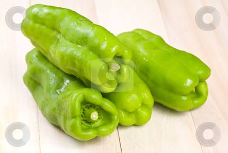 Group of green bell peppers stock photo, group of green bell peppers on wooden background by Lawren