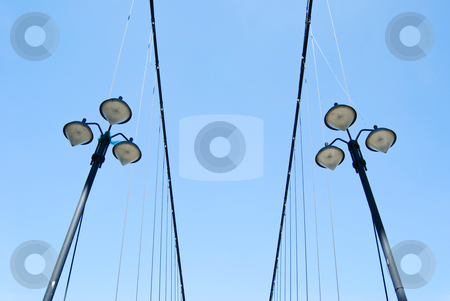 Street lamps under blue sky stock photo, Street lamps under blue sky on the side of suspending bridge by Lawren