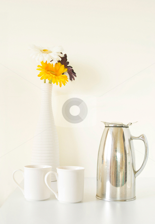 White cup set and  vase on white table stock photo, White cup set and  vase on white table by Lawren