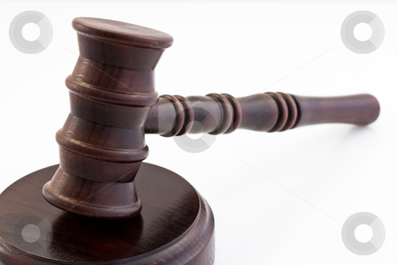 Wooden judge gavel and stand stock photo, wooden judge gavel and wooden stand on a white background by ludinko