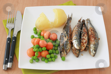 Fried sardines with potato stock photo, fried sardines with potato on a plate by nataliamylova