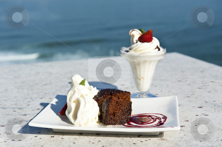 Warm chocolate pudding and ice cream stock photo, Warm chocolate pudding and ice cream on a tropical island by tish1