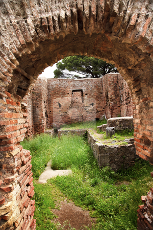 Ancient Roman Arch Ruins Ostia Antica Rome Italy stock photo, Ancient Roman Arch Ruins Ostia Antica Ruins Rome Italy Excavation of Ostia, ancient Roman port, next to airport.  Was port for Rome until 5th Century AD.  by William Perry