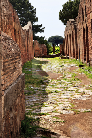 Ancient Roman Road Ruins Ostia Antica Rome Italy stock photo, Ancient Roman Road Ruins Ostia Antica Ruins Rome Italy Excavation of Ostia, ancient Roman port, next to airport.  Was port for Rome until 5th Century AD.  by William Perry