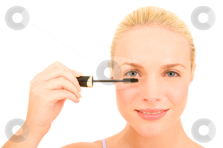 Woman applying mascara stock photo, Woman applying mascara by ambrophoto