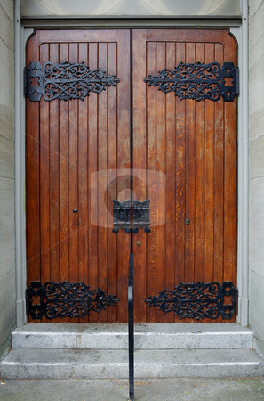 Church Doors with ornate hinges stock photo, Stained wood church doors ...