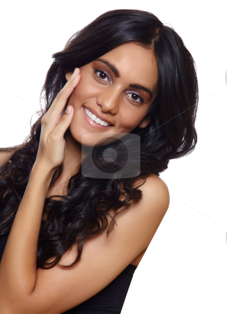 Smiling woman with long hair stock photo, beautiful woman with long black curly hair, tanned skin and natural make-up over white background. by lubavnel