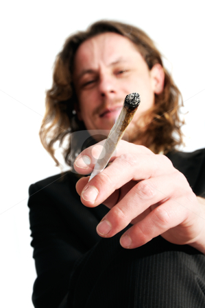 Man smoking weed stock photo, Young business man smoking weed after work by www.ericfahrner.com