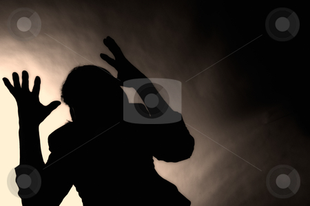 Silhouette of depressed man stock photo, Concept shot of depressed and hopeless man. by www.ericfahrner.com